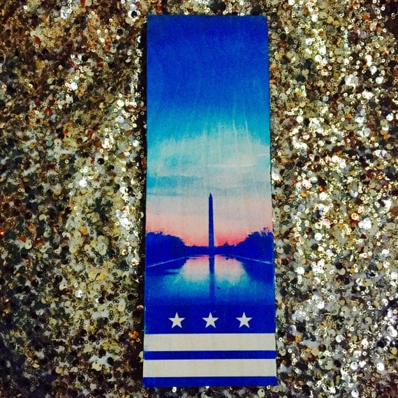 Washington Monument with the DC Flag