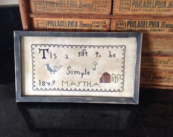 """Primitive """"Tis a gift to be simple"""" cross stitched sampler"""