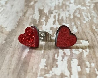 Nickel free!  Tiny red glitter heart studs