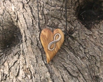 Heart shaped olive wood pendant with inlaid eternity symbol
