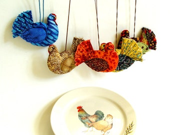 Hanging hen ornament in colorful fabrics
