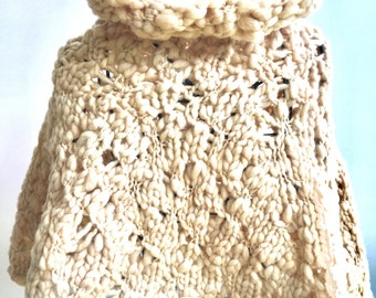 Knitted cape in pure wool for evening cover up