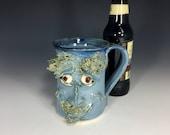 Happy happy joy joy blue smiley face mug with bright porcelain eye balls