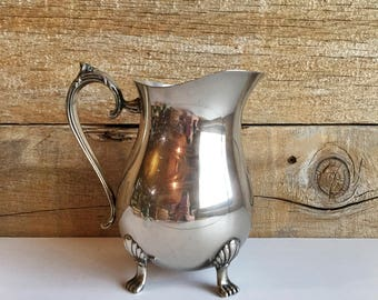 Leonard Silverplated water pitcher. Silver pitcher with ice guard.