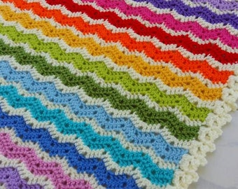 Crocheted rainbow ajour ripple blanket