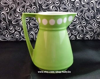 Vintage jadeite green coffee creamer handpainted with a stamp on bottom