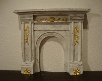 fireplace Carrara marble effect and gold leaf