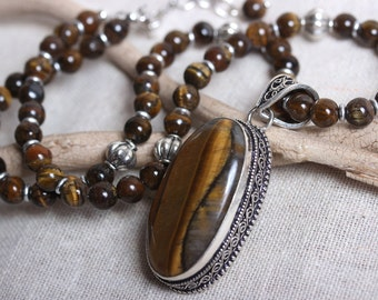 Ornate Sterling Silver and Iron Tigers Eye Pendant with Necklace of Brown Tigers Eye and Silver Melon Beads