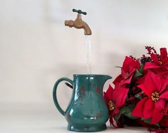 Kokopelli Pitcher Water Fountain with Illusion