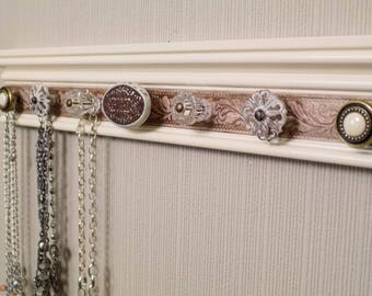 jewelry holder This wall necklace organizer w/7 decorative cabinet knobs  on ivory background with a bronze embossed section 20*