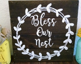 Bless our nest pallet wood sign with wreath wall hanging.