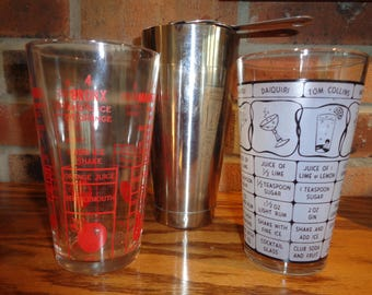 3 Vintage Bar Ware Mixing Glasses with recipes printed on two glasses and a stainless steel cup to shake things up after you mix them up