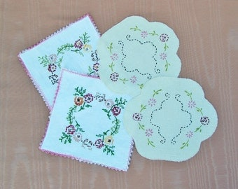 Lot of 4 vintage embroidered doilies, 2 muslin doilies with cross stitch embroidery and pink crocheted trim, 2 embroidered linen doilies