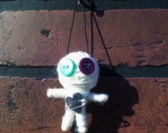 Cream String Doll