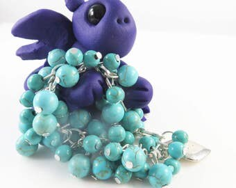 Polymer clay dragon with girls cha cha bracelet
