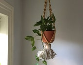 bohemian yarn macrame hanging planter. vintage boho macrame planter. 1970s yellow brown white boho hippy mid century plant braided hanger