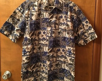 Short sleeved men's shirt with tropical theme.