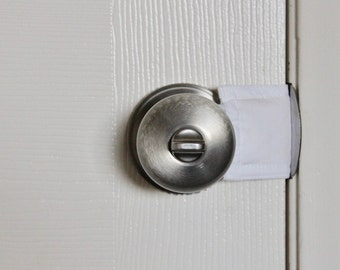 Latchy Catchy in All White (Patented)  door latch cover for classrooms, school, teachers, school rooms.