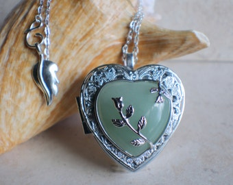 Aventurine quartz music box locket, heart shaped locket with music box inside, in silver tone with aventurine quartz crystal heart.