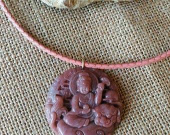 Fabulous jade Buddha pendant on pink leather choker.