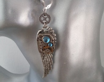 Earring steampunk with a feather