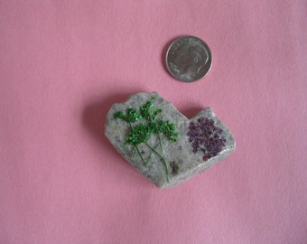 Natural heart rock with dried flowers