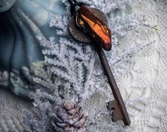 Crimson Peak ⊽ amber titanium aura crystal wrapped onto a victorian cast iron skeleton key necklace