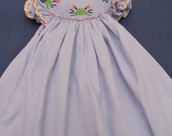 Hand smocked bishop style dress with green crabs
