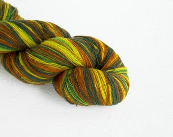 Artistic wool, laceweight art wool green brown yellow colors, Longstriped artistic wool. Aade Long