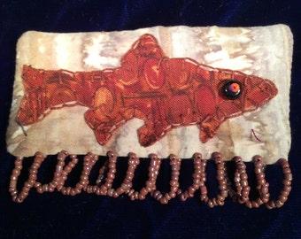Google-eyed fish pin brooch