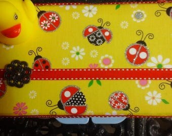 wipe case for the new little one for a shower gift or just going to meet the new little one.this fabric really sparkles