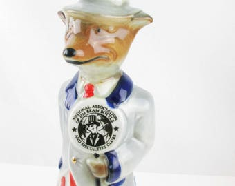A 1971 Beam Decanter - Red, White, Blue Outfit - Fox With Blue Ribbon - 'National Association of Jim Beam Bottle and Specialties Clubs'
