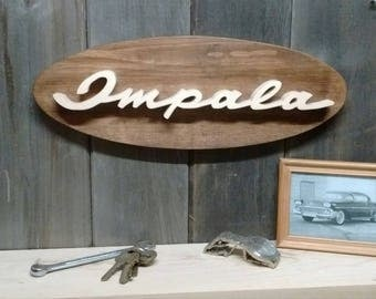1958 Chevrolet Impala Emblem Oval Wall Plaque-Unique scroll saw automotive art created from wood for your garage, shop or man cave.