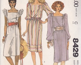 McCalls 8429 Vintage Pattern Womens Pull On Dress With Side Button Opening In 3 Variations Size 12 Bust 34 UNCUT