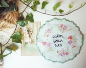 Hand embroidered doily wall hanging - calm your tits