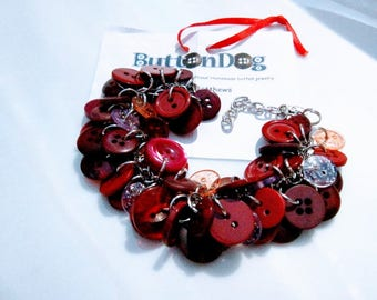 Red red wine, ruby red button bracelent with sparkles throughout.