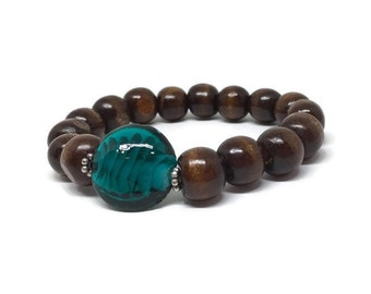 CLEARANCE - Nice wood beads bracelet with a dark green glass bead in the center