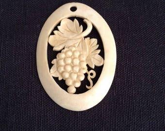 1910's of bone pendant.