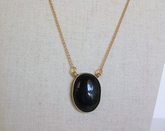 Black Oval Pendant on Gold Chain