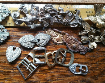 Vintage pieces of costume jewelry and rhinestone buttons