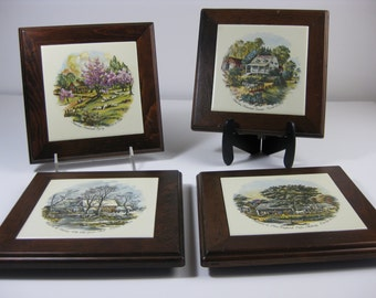 Vintage Currier and Ives decorative ceramic trivets, wood framed with country seasons from Three Mountaineers