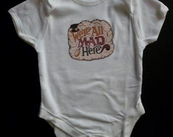 Alice in wonderland we're all mad here babygrow