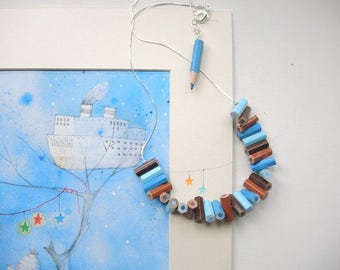 Wooden necklace with blue, blue and brown colored pencils