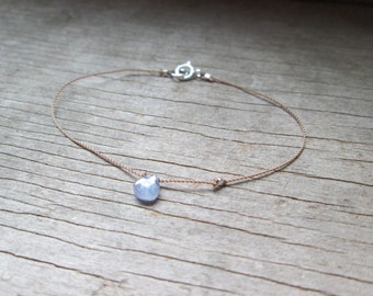 tiny TANZANITE drop bracelet on a thin silk cord with fine silver nugget bead December birthstone daintydelicate  minimalist hand knotted
