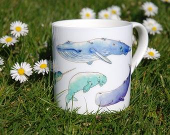 Beautiful china mug with original narwhal, manatee and whales design