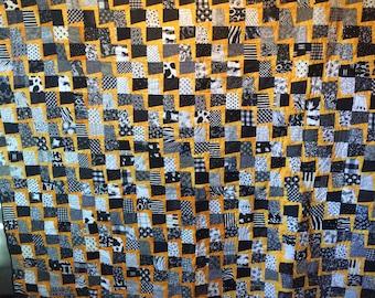 Lightening Strike Quilt 93x81 inches in Black & White and orange/yellow fabrics