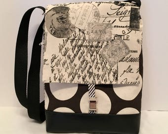 Adult purse: French script fabric iPad Bag with zipper front pocket and top closure, inside pocket and an adjustable strap