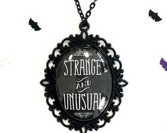 Strange and Unusual black pendant necklace * Beetlejuice inspired*