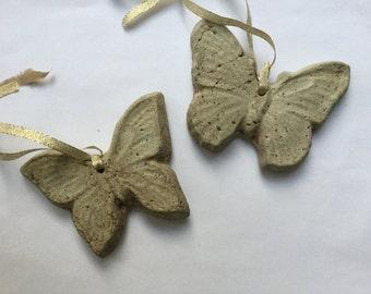 2 solid concrete rustic butterflies