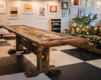 reclaimed 100 year old barnwood trestle dining table